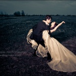 Wedding couple dancing in field