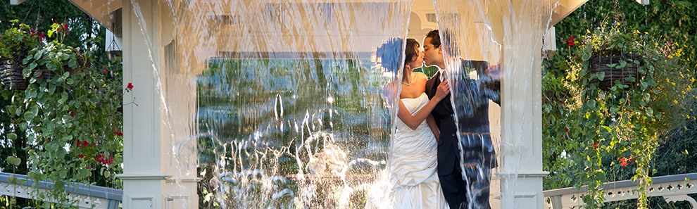 Couple kissing under waterfall